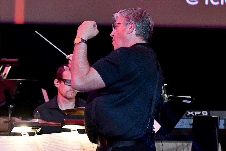 Mark Watters conducts the orchestra at WORDS + MUSIC, presented Thursday, June 29, 2017 at the Television Academy's Wolf Theatre at the Saban Media Center in North Hollywood, California.