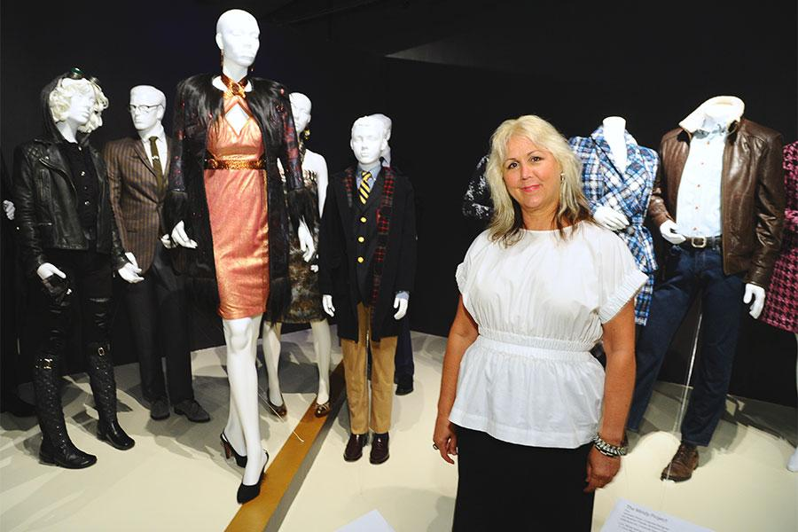 Costume designer Lisa Padovani with some of her costumes from Gotham at The 9th Annual Outstanding Art of Television Costume Design Exhibition at the FIDM Museum & Galleries, Saturday, July 18, 2015, in Los Angeles.