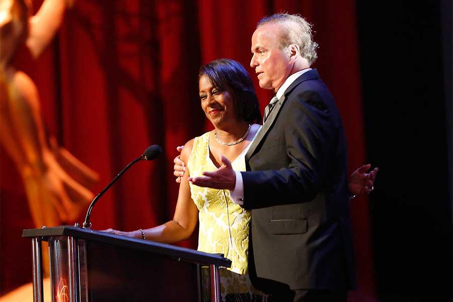 Pat Harvey and David Goldstein present an award at the 68th Los Angeles Area Emmys, July 23, 2016, at the Saban Media Center, North Hollywood, California.