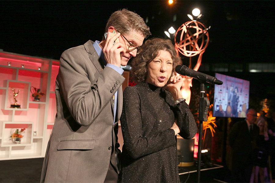 Porky Pig (Television Academy governor Bob Bergen) and Ernestine (Television Academy governor Lily Tomlin) have a conversation at the Performers Nominee Reception, September 16, 2016 at the Pacific Design Center, West Hollywood, California.