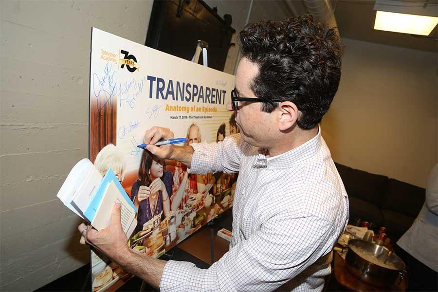 Moderator J.J. Abrams signs a poster at Transparent: Anatomy of an Episode, March 17, 2016 in Los Angeles.