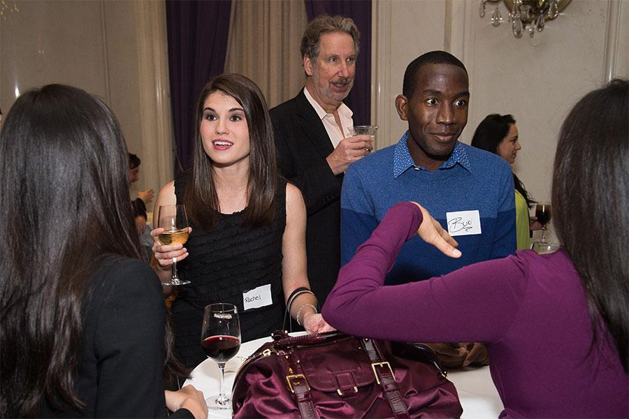 Rachel Pierce and Buki Elegbede chat with friends at the New York Networking Night Out, November 13, 2015 at the St. Regis in New York City.