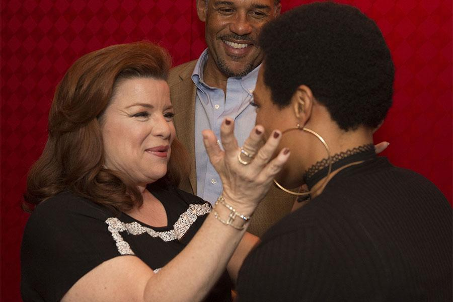"""Renee Lawless greets April Parker Jones at the Television Academy's first member event in Atlanta, """"A Conversation with Tyler Perry,"""" at the Woodruff Arts Center on Thursday, May 4, 2017."""