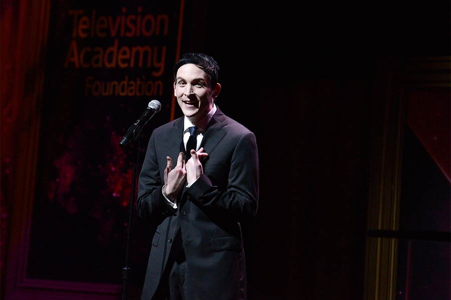 Robin Lord Taylor presents an award at the 36th College Television Awards at the Skirball Cultural Center in Los Angeles, California, April 23, 2015.
