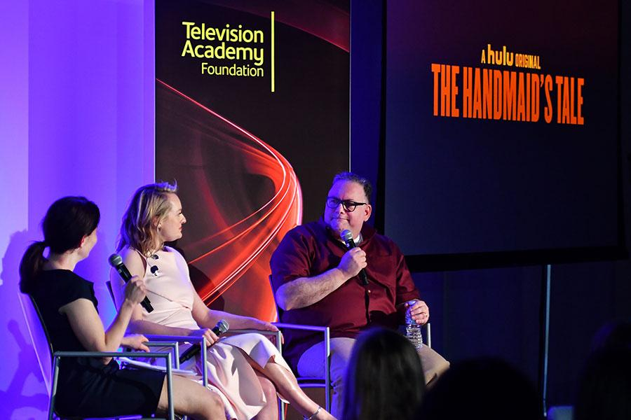 Beatrice Springborn, Elisabeth Moss, and Bruce Miller at The Handmaid's Tale: From Script to Screen at the Wolf Theatre at the Saban Media Center in North Hollywood, California.
