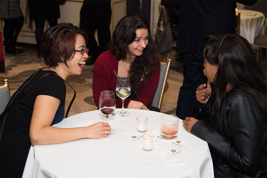 Stephanie Hui and Jenna Hellmuth chat with a friend at the New York Networking Night Out, November 13, 2015 at the St. Regis in New York City.