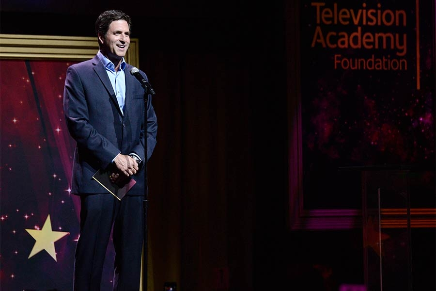 Steve Levitan presents an award at the 36th College Television Awards at the Skirball Cultural Center in Los Angeles, California, April 23, 2015.