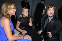 Edie Falco, Amy Poehler and Peter Dinklage share a look of surprise in the Audi Green Room at the 65th Emmy Awards.