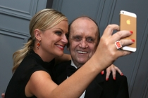 Amy Poehler takes a selfie with Bob Newhart in the Audi Green Room at the 65th Emmy Awards.