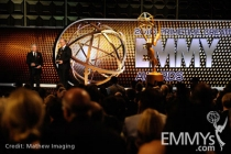 Norman Brokaw accepts the Governors Award from John Shaffner onstage during the 62nd Primetime Creative Arts Emmy Awards