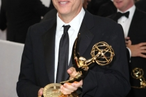 """Jon Stewart with the award for """"Outstanding Variety, Music or Comedy Series"""" at the trophy table"""