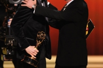 "(L-R) Jim Parsons accepts the award for ""Outstanding Lead Actor in a Comedy Series"" from Charlie Sheen"