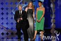 """Phitz Hearne accepts the award for Outstanding Sound Editing for NonFiction Programming """"America The Story of Us"""" onstage"""