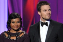 Mindy Kaling and Stephen Amell on stage at the 65th Emmys