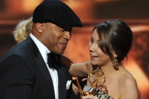 LL Cool J presents Tracey Wigfield with the award for Outstanding Writing for a Comedy Series