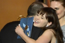 Emily Deschanel and Zooey Deschanel present Tony Hale with the award for Outstanding Supporting Actor in a Comedy