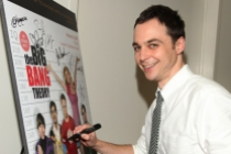 "Jim Parsons autographs the evening's poster at ""An Evening with The Big Bang Theory"""