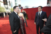 Ricky Gervais, with guest Jane Fallon, greets Steve Carell at the 60th Primetime Emmy Awards