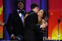 Actor Jim Parsons (C) accepts his award from actors L.L. Cool J (L) and Eva Longoria Parker onstage at the 62nd Annual Primetime
