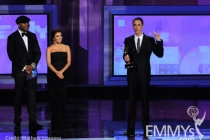 Actor Jim Parsons (R) accepts his award from actors L.L. Cool J (L) and Eva Longoria Parker onstage at the 62nd Annual Primetime