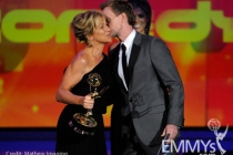 Actress Edie Falco accepts her award from actor Neil Patrick Harris onstage at the 62nd Annual Primetime Emmy Awards held at the