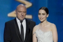 Dean Norris and Emilia Clarke on stage at the 65th Emmys