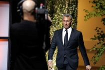 Adam Shenkman enters the stage at the 37th College Television Awards at the Skirball Cultural Center on Wednesday, May 25, 2016, in Los Angeles.