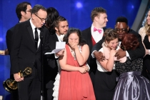"""The team and cast from """"Born This Way"""" accept the award for outstanding unstructured reality program during night two of the Television Academy's 2016 Creative Arts Emmys."""