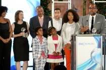 The black-ish cast looks on as producer Kenya Barris accepts the award at the awards presentation at the Eighth Annual Television Academy Honors, May 27 at the Montage Beverly Hills.