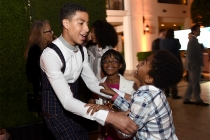 Marcus Scribner, Marsai Martin, and Miles Brown of black-ish wait to go onstage at the awards presentation at the Eighth Annual Television Academy Honors, May 27 at the Montage Beverly Hills.