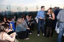 Peer group members and guests enjoy the picturesque rooftop setting at the London Hotel in West Hollywood, California.