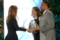 Host Dana Delaney presents the award Corey Nickerson and Kenya Barris, producers of black-ish, at the awards presentation at the Eighth Annual Television Academy Honors, May 27 at the Montage Beverly Hills.