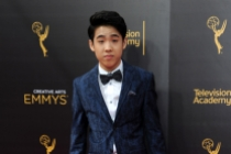 Lance Lim arrives on the red carpet at the 2016 Creative Arts Emmys.