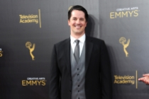Chris Bacon on the red carpet at the 2016 Creative Arts Emmys.