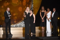 The Game of Thrones makeup team accept an award at the 2016 Creative Arts Emmys.