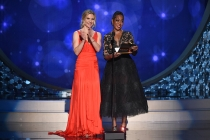 Rhea Seehorn and Tichina Arnold on stage at the 2016 Creative Arts Emmys.