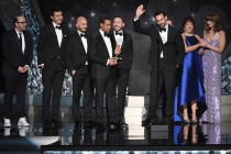 "The team from ""Last Week Tonight with John Oliver"" accepts the award for outstanding writing for a variety series during night two of the Television Academy's 2016 Creative Arts Emmys."