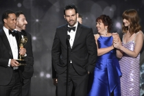 """The team from """"Last Week Tonight with John Oliver"""" accepts the award for outstanding writing for a variety series during night two of the Television Academy's 2016 Creative Arts Emmys."""