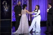 Chris Sullivan and Susan Kelechi Watson present an award to Ava DuVernay at the 2017 Creative Arts Emmys.