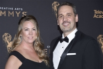 Darren Hallihan and guest on the red carpet at the 2017 Creative Arts Emmys.
