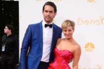 Ryan Sweeting and Kaley Cuoco-Sweeting of The Big Bang Theory arrive at the 66th Emmys.