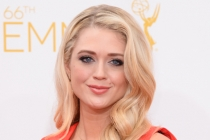 Brooke Newton arrives at the 66th Emmy Awards.