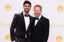 Jesse Tyler Ferguson of Modern Family and his husband Justin Mikita arrive at the 66th Emmy Awards.