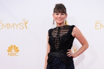 Yael Stone of Orange is the New Black arrives at the 66th Emmy Awards.