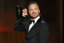 Aaron Paul of Breaking Bad accepts an award at the 66th Emmys.