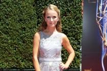 Brooke Anderson arrives for the 2014 Primetime Creative Arts Emmys.