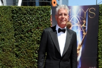 Anthony Bourdain arrives for the 2014 Primetime Creative Arts Emmys.