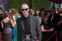 Neville Kidd arrives for the 2014 Primetime Creative Arts Emmys.