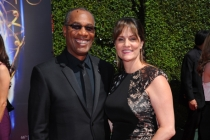 Joe Morton of Scandal and wife Nora Chavooshian arrives for the 2014 Primetime Creative Arts Emmys.