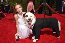 G. Hannelius and the dog of Dog With a Blog arrive for the 2014 Primetime Creative Arts Emmys.